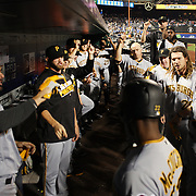 NEW YORK, NEW YORK - June 16: Andrew McCutchen #22 of the Pittsburgh Pirates is congratulated by team mates as he returns to the dugout after hitting a home run during the Pittsburgh Pirates Vs New York Mets regular season MLB game at Citi Field on June 16, 2016 in New York City. (Photo by Tim Clayton/Corbis via Getty Images)