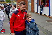 Crystal Palace midfielder James McArthur (18) poses for a photograph with a fan ahead of the Premier League match between Crystal Palace and Everton at Selhurst Park, London, England on 27 April 2019.