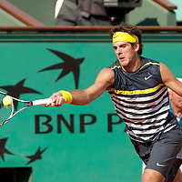 1 June 2009: Juan Martin Del Potro of Argentina eyes the ball as he stretches for a forehand during the Men's Single Fourth Round match on day nine of the French Open at Roland Garros in Paris, France.