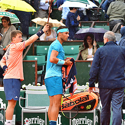Rafael Nadal of Spain  gathers his things as rain interrupts the match for a second time during Day 11 of the French Open 2018 on June 6, 2018 in Paris, France. (Photo by Dave Winter/Icon Sport)