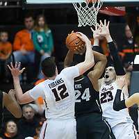 Oregon State's Drew Eubanks (12) blocks Colorado's George King's shot from behind during the first half of an NCAA college basketball game in Corvallis, Ore., Thursday, Feb. 16, 2017. (AP Photo/Timothy J. Gonzalez)