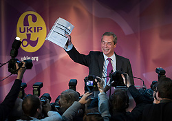© Licensed to London News Pictures. 28/11/2016. London, UK. Nigel Farage holds up the Electoral Commission registration form for the new leader before Paul Nuttall is announced as the new leader of the UK Independence Party (UKIP), at the Emmanuel Centre in Westminster London. Previously Paul Nuttall failed to become leader after missing the deadline to fill in the form. Photo credit: Peter Macdiarmid/LNP