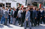 Roma 24 Maggio1988.Il funerale di Giorgio Almirante e Pino Romualdi a Piazza Navona. Gianfranco Fini segue la bara che viene portata tra gli altri da Maurizio Gasparri, Giuseppe Tatarella, vicino Domenico Gramazio