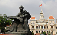 The statue of Ho Chi Minh in front of the Communist Party Headquartersin downtown, Saigon--Ho Chi Minh City,<br /> <br />  photo by Dennis Brack