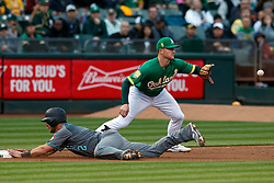 OAKLAND, CA - MAY 25:  Jeff Mathis #2 of the Arizona Diamondbacks dives into third base ahead of a tag from Matt Chapman #26 of the Oakland Athletics during the third inning at the Oakland Coliseum on May 25, 2018 in Oakland, California. The Arizona Diamondbacks defeated the Oakland Athletics 7-1. (Photo by Jason O. Watson/Getty Images) *** Local Caption *** Jeff Mathis; Matt Chapman