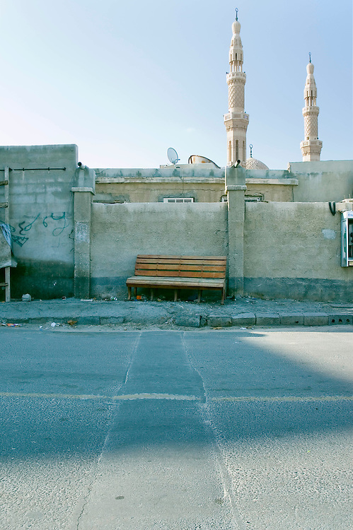 An abandoned bench lies by a street in Satwa, Dubai on Jan 28, 2005 Archive of images of Dubai by Dubai photographer Siddharth Siva