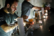 A bartender mixes drinks at the Ace Hotel on November 5, 2013, in London, United Kingdom. (Warrick Page for The New York Times)