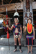 Naga couple in front of their tribe's Morung or hut