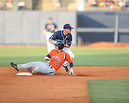 Mississippi's Kevin Mort (6) forces out Auburn's Justin Fradejas (20) during a college baseball in Oxford, Miss. on Friday, May 21, 2010. (AP Photo/Oxford Eagle, Bruce Newman)