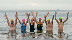 Edinburgh, Scotland, UK. 6 August, 2019. Wild swimmer Liz Richardson, who has created and is performing in SWIM at the Pleasance during the Edinburgh Fringe Festival, invited Fringe workers to join her for a group dip in the Firth of Forth at Portobello Beach. The idea is to promote health and wellbeing during the Festival. Liz Richardson wants to share her positive experiences of outdoor swimming and provide an opportunity for people to switch off and tune into nature. Iain Masterton/Alamy Live News