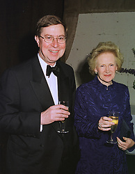 DR ALAN BORG director of the V&A  and his wife LADY CAROLINE BORG, at a dinner in London on 16th January 1999.MNF 9