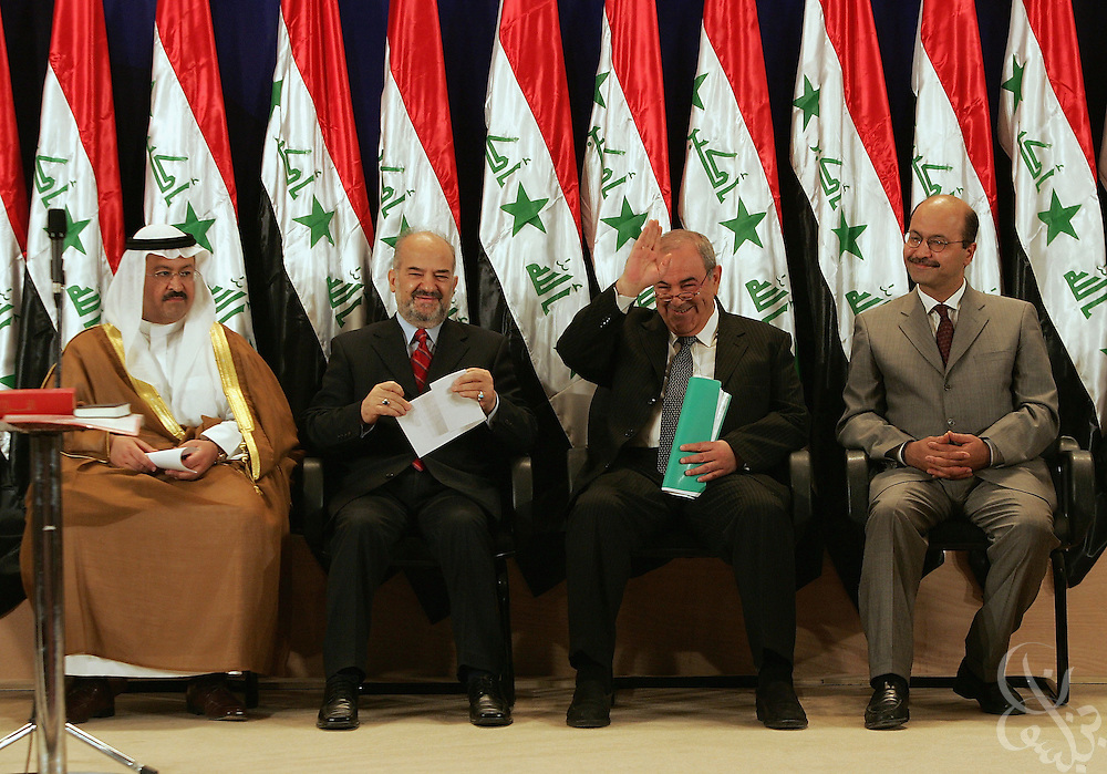 (From left) Iraqi Interim President Ghazi al-Yawar, interim Vice President Ibrahim al-Jaafari, interim Prime Minister Iyad Allawi and Deputy Prime Minister Barham Salih wave to a crowd assembled to witness their June 28, 2004 signing-in ceremony in Baghdad, Iraq.  Ibrahim al-Jaafari