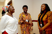16635African Leadership Day: Photos by Colby Ware..9/24/04--(from left) Graduate students Basetsana Maposa, Margaret Sackey and Aissatou Balde take a break from the African Leadership Conference to share a few laughs.