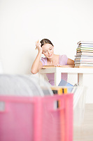 Young woman sits working at books