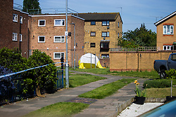 A view of the estate with the tent marking the spot where a 24 year old male known locally as Mali died at the scene of yet another murder, this time on an estate on Crows Road in Barking, London, May 18 2018.