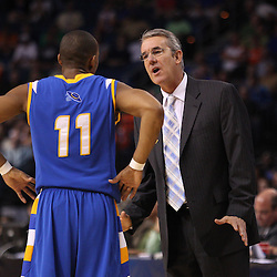 Mar 17, 2011; Tampa, FL, USA; UC Santa Barbara Gauchos head coach Bob Williams and guard Justin Joyner (11) talk during first half of the second round of the 2011 NCAA men's basketball tournament against the Florida Gators at the St. Pete Times Forum.  Mandatory Credit: Derick E. Hingle