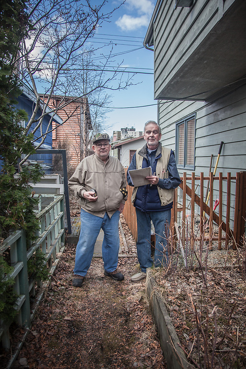 """""""We both grew up in this neighborhood and we never moved away.  I've been a surveyor since 1953 and I have over 15,000 as-builts filed in my office.  I don't even own a comuputer.""""  -Licensed Surveyor R.L. Button (right) with his assistant Nick Ihly in Anchorage's South Addition neighborhood"""