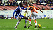 Martin Patterson brought down by Wigan Defender Leon Barnett during the Sky Bet League 1 match between Wigan Athletic and Blackpool at the DW Stadium, Wigan, England on 12 December 2015. Photo by Pete Burns.