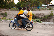 Since Haiti is ranked the poorest nation in the Western Hemisphere, with 80 percent of the population living on an income of less than $2 a day, owning a vehicle is uncommon. Sometimes three people squeeze onto a motorcycle in order to get around the country.