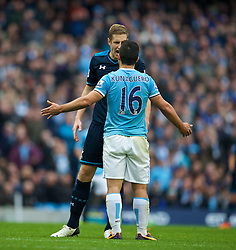 MANCHESTER, ENGLAND - Sunday, November 24, 2013: Manchester City's Sergio Aguero clashes with Tottenham Hotspur's Michael Dawson during the Premiership match at the City of Manchester Stadium. (Pic by David Rawcliffe/Propaganda)