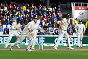 Wicket - Pat Cummins of Australia is caught by Ben Stokes of England off the bowling of Jack Leach of England during the International Test Match 2019, fourth test, day two match between England and Australia at Old Trafford, Manchester, England on 5 September 2019.