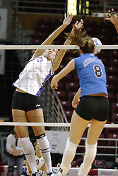 24 November 2006: Lauren Bloemke strikes the ball past Kristin Belzung during a Semi-final match between the Creighton University Bluejays and the Northern Iowa University Panthers. The Tournament was held at Redbird Arena on the campus of Illinois State University in Normal Illinois.<br />