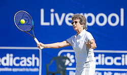 LIVERPOOL, ENGLAND - Friday, June 21, 2013: Virginia Wade coaches children on centre court during Day Two of the Liverpool Hope University International Tennis Tournament at Calderstones Park. (Pic by David Rawcliffe/Propaganda)