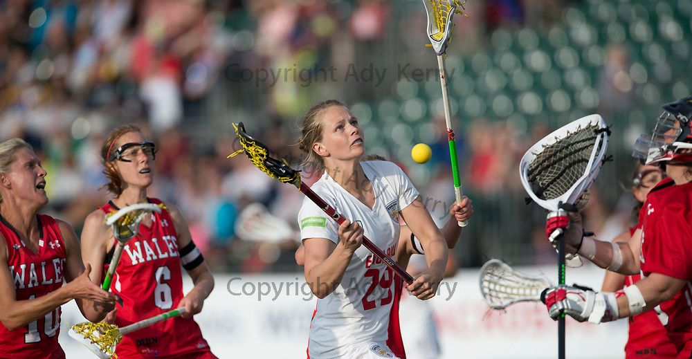 England's Camilla Hayes is denied by the Wales defence in the quarter Final at the 2017 FIL Rathbones Women's Lacrosse World Cup, at Surrey Sports Park, Guildford, Surrey, UK, 19th July 2017.