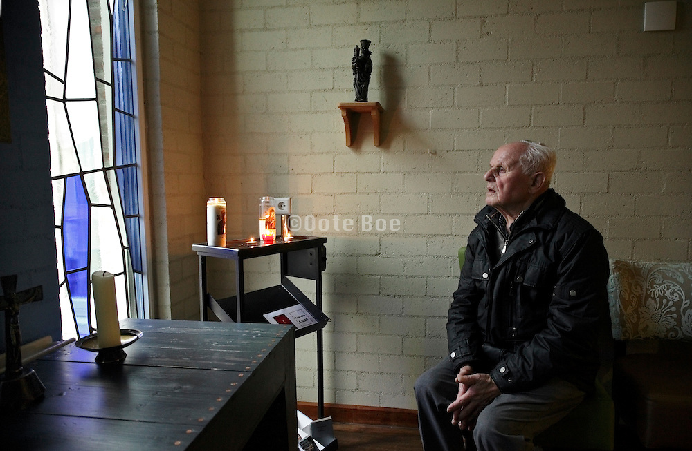 chapel with a elderly man inside a retirement home
