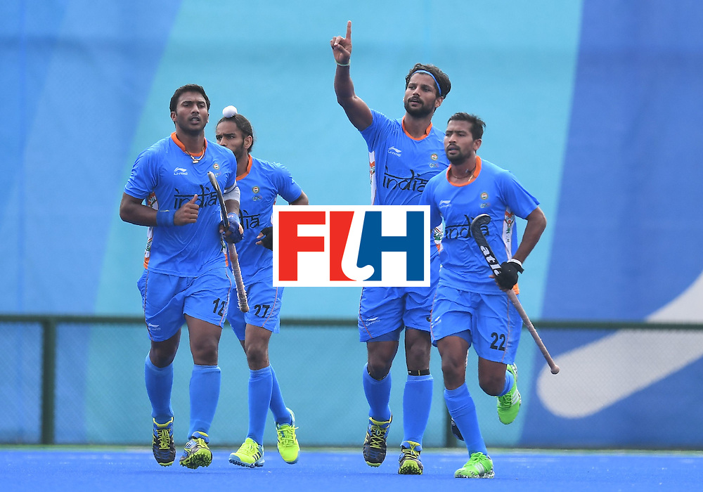 India's Rupinder Pal Singh (2R) celebrates scoring a goal during the men's field hockey Germany vs India match of the Rio 2016 Olympics Games at the Olympic Hockey Centre in Rio de Janeiro on August, 8 2016. / AFP / MANAN VATSYAYANA        (Photo credit should read MANAN VATSYAYANA/AFP/Getty Images)