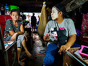 17 OCTOBER 2018 - BANGKOK, THAILAND: A woman and girl backstage get ready to perform in the Chinese opera on the last night of the Vegetarian Festival at Chit Sia Ma Shrine in Bangkok's Chinatown. The Vegetarian Festival, also called the Nine Emperor Gods Festival, is a nine-day Taoist celebration beginning on the eve of 9th lunar month of the Chinese calendar. Traditional Chinese operas, called Ngiew in Thailand, are sponsored at many Chinese shrines and temples during the Vegetarian Festival.  PHOTO BY JACK KURTZ