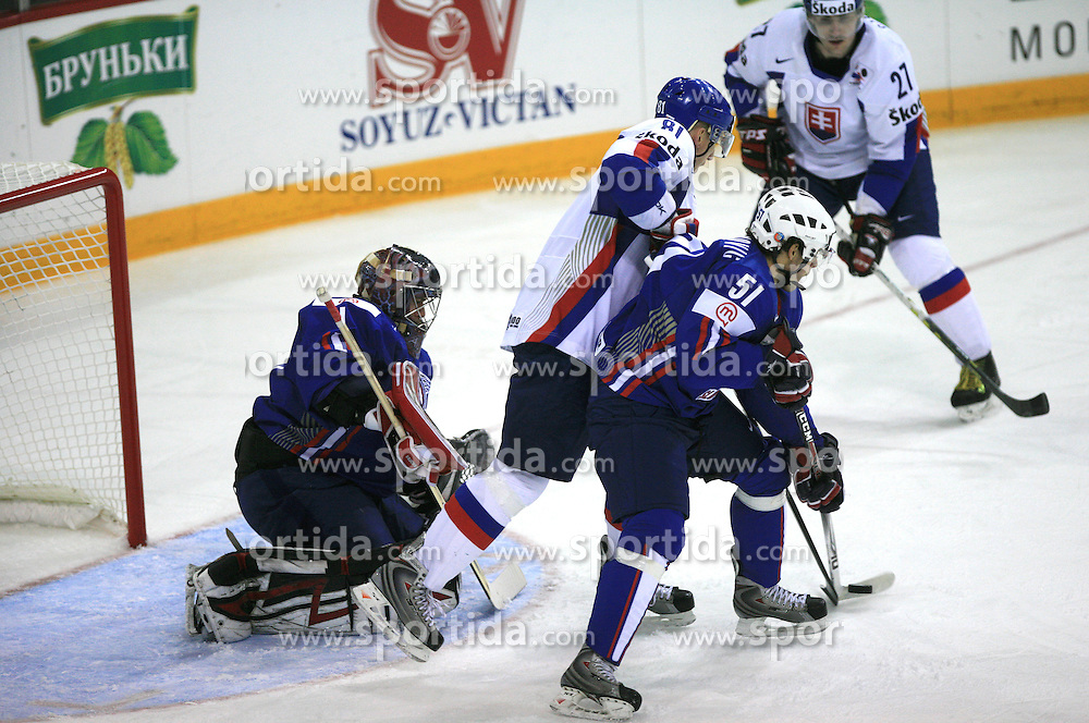 Jakob Milovanovic of Slovenia (51), Marcel Hossa of Slovakia (81) and Goalkeeper of Slovenia Andrej Hocevar at ice-hockey game Slovenia vs Slovakia at second game in  Relegation  Round (group G) of IIHF WC 2008 in Halifax, on May 10, 2008 in Metro Center, Halifax, Nova Scotia, Canada. Slovakia won after penalty shots 4:3.  (Photo by Vid Ponikvar / Sportal Images)