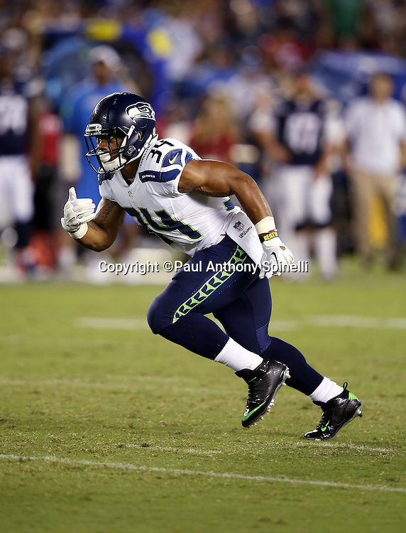 Seattle Seahawks running back Thomas Rawls (34) takes a handoff during the 2015 NFL preseason football game against the San Diego Chargers on Saturday, Aug. 29, 2015 in San Diego. The Seahawks won the game 16-15. (©Paul Anthony Spinelli)