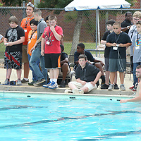 Tiger Tech Camp students gather poolside at Northeast Community College as they pilot their SeaPerch Robots through an underwater obstacle course during camp Wednesday in Booneville.