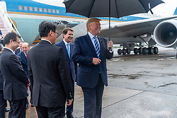 June 27, 201, Osaka, Japan: President DONALD J. TRUMP disembarks Air Force One, Thursday upon his arrival to Osaka International Airport to attend the G20 Summit. Trump is seeking to resolve an escalating trade fight with China and is expected to hold trade talks with the Chinese president Saturday morning.  (Credit Image: © Shealah Craighead/White House/ZUMA Wire)