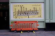 Construction barrier and Libyan postal stamp mural image.