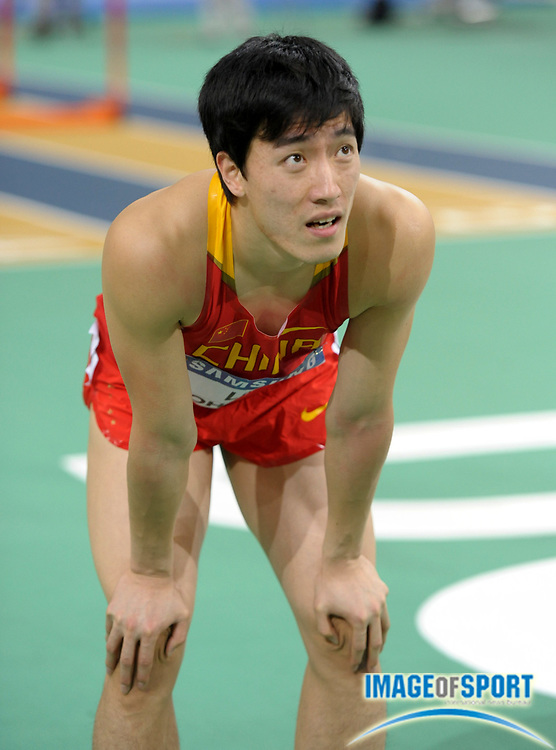 Mar 14, 2010; Doha, QATAR; Xiang Liu (CHN) watches a video replay of the 60m hurdles in the IAAF World Indoor Championships at the Aspire Dome. Liu was seventh in 7.65.