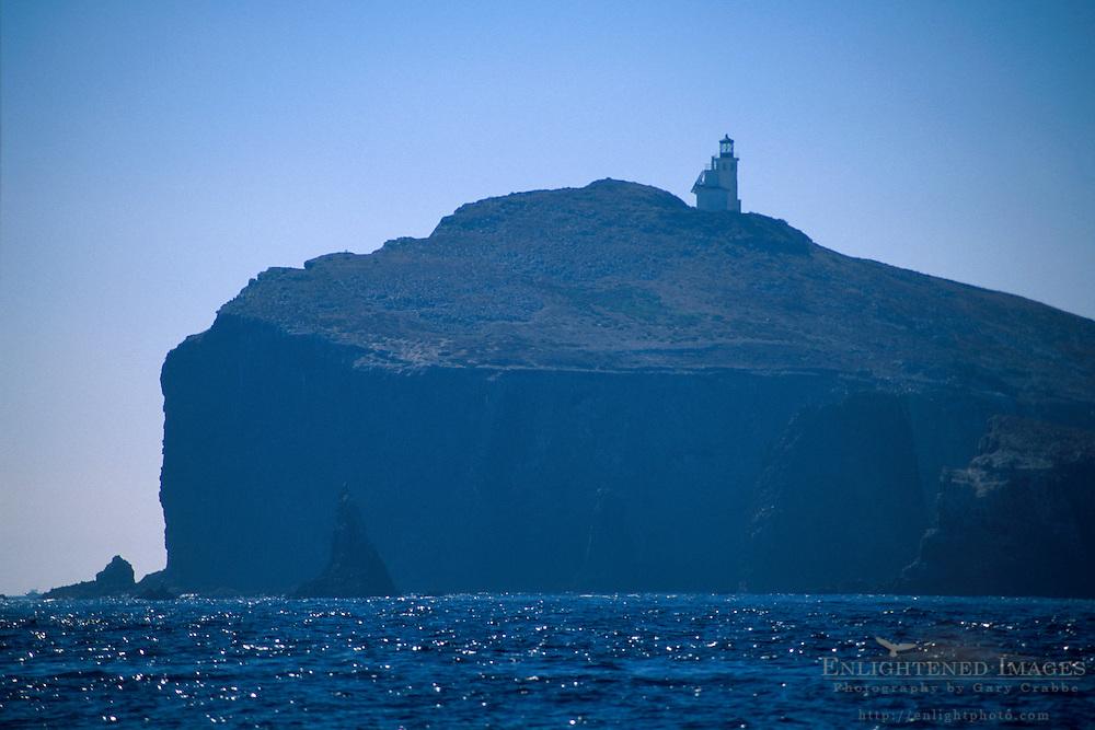 Lighthouse above steep rocky coastal cliff on Anacapa Islands, Channel Islands National Park, California Coast
