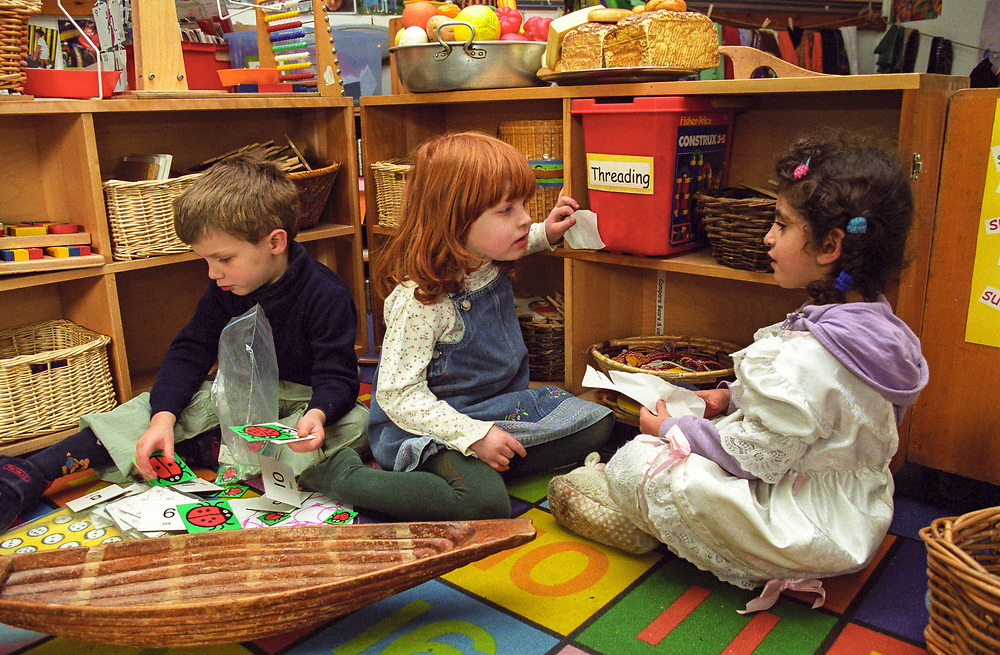 children talking and playing at a nursery school