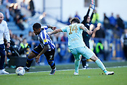 Kadeem Harris of Sheffield Wednesday dribbles passed Ryan Manning of Queens Park Rangers during the EFL Sky Bet Championship match between Sheffield Wednesday and Queens Park Rangers at Hillsborough, Sheffield, England on 31 August 2019.