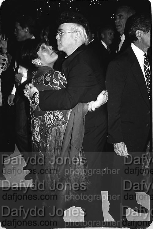 Elton John dancing  with Linda Stein at Vanity Fair magazine's Phoenix House benefit. Los Angeles. March 1990.<br /><br />© Copyright Photograph by Dafydd Jones<br />66 Stockwell Park Rd. London SW9 0DA<br />Tel 0171 733 0108<br />Film.901190/28