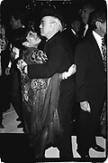 Elton John dancing  with Linda Stein at Vanity Fair magazine's Phoenix House benefit. Los Angeles. March 1990.<br />