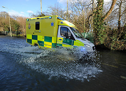 © Licensed to London News Pictures. Date 9 Jan 2014. Oxford. Ambulance sped to an emergency down the Abingdon Road. River Thames floods at Oxford causing the closure of the Abingdon and Botley roads.. Photo credit : MarkHemsworth/LNP