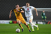 Milton Keynes Dons defender Jordan Moore-Taylor (15) battles for possession  with Port Vale forward Tom Pope (9) during the The FA Cup match between Milton Keynes Dons and Port Vale at stadium:mk, Milton Keynes, England on 9 November 2019.