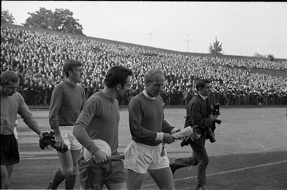 Waterford FC vs Manchester United at Lansdowne Road..1968..18.09.1968..09.18.1968..18th September 1968..Waterford FC as champions of the league of Ireland drew Manchester United, the European Champions,in the first round of this years competition.The Waterford team was as follows: Peter Thomas, Peter Bryan, Noel Griffin, Vinny Maguire, Jackie Morley, Jimmy McGeough, Al Casey, Alfie Hale, John O'Neill, Shamie Coad and Johnny Matthews. Manchester United won the tie 3 -1 with Denis Law being the man of the match..Alex Stepney,Tony Dunne,Francis Burns,Paddy Crerand,.Bill Foulkes,Nobby Stiles,George Best,Denis Law,.Bobby Charlton,David Sadler,Brian Kidd were the starting eleven for United..The players take the field for the European Cup match at Lansdowne Road.