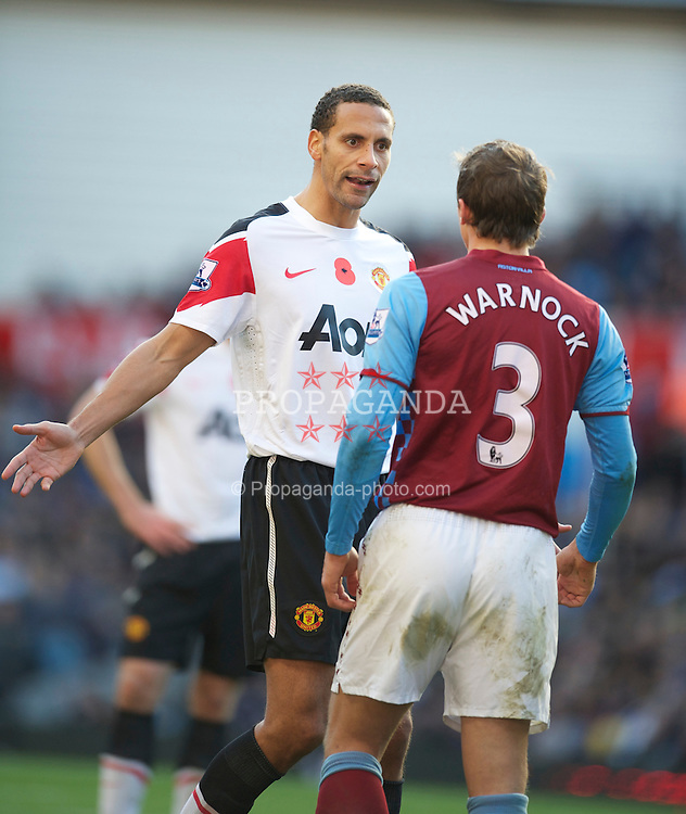 BIRMINGHAM, ENGLAND - Saturday, November 13, 2010: Aston Villa's Stephen Warnock clashes with Manchester United's Rio Ferdinand during the Premiership match at Villa Park. (Photo by David Rawcliffe/Propaganda)
