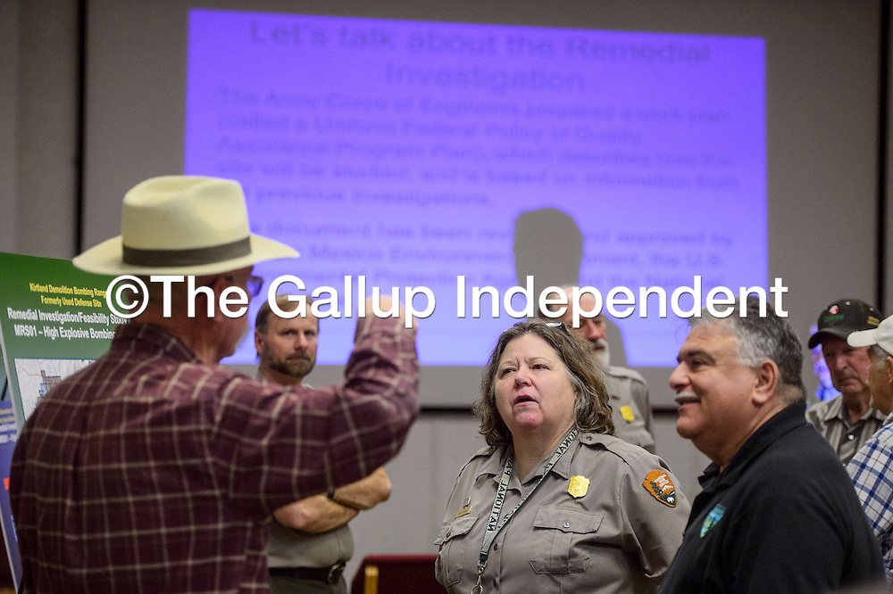 El Malpais National Monument superintendent Mitzi Frank, center, answers questions from visitors during a community meeting about ordinance disposal at the El Malpais visitors center in Grants Wednesday.