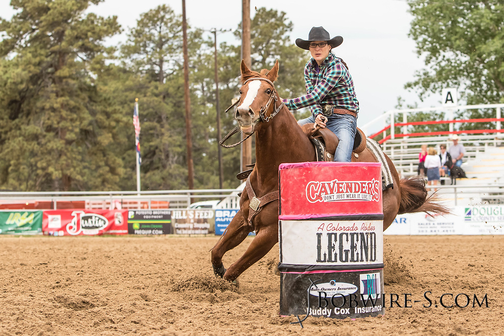 Mary Cecelia Tharpe makes her barrel racing run during slack at the Elizabeth Stampede on Sunday, June 3, 2018.