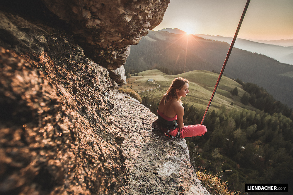 Hedi Friedl having a rest on top of her last route of the day, in a beautiful sunset on the Loferer Alm