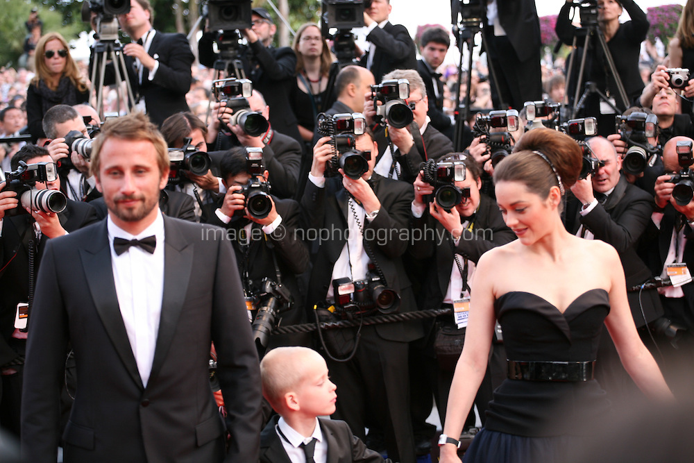 Actor Matthias Schoenaerts and Actress Marion Cotillard at the gala screening of the film De rouille et d'os at the 65th Cannes Film Festival. Thursday 17th May 2012, the red carpet at Palais Des Festivals in Cannes, France.